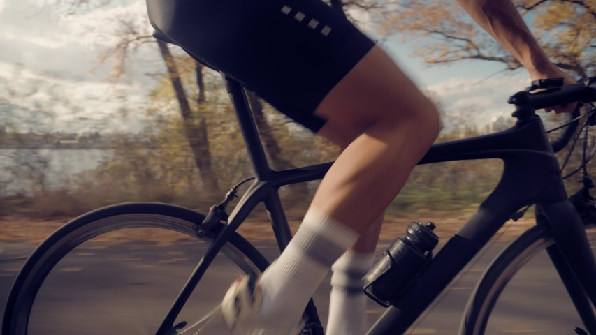 Cycling Athlete Cardio Endurance Workout.Cyclist Twists Pedals And Riding On Bicycle.Gear System And Bike Wheel Rotation.Cyclist Legs Triathlete Pedaling And Exercising Before Triathlon.Sport Concept | Shutterstock HD Video #1040661221