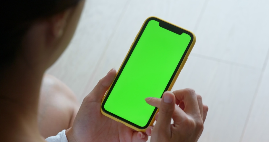Woman use of mobile phone with green screen at home | Shutterstock HD Video #1040677922