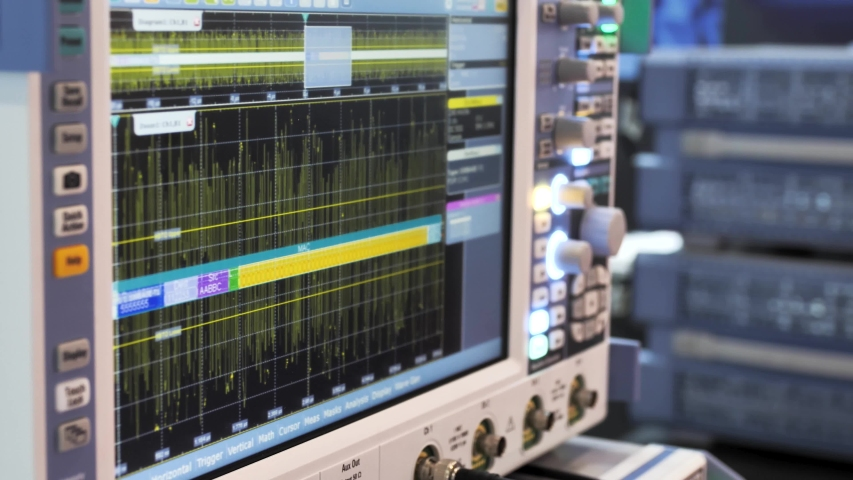 Modern device oscilloscope display with waves.