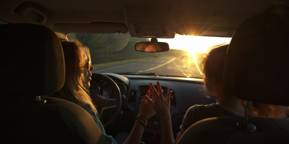 Fun multinational Young Women Dance and laugh in Moving Car. Slow Motion. Sunset on background. flares   Shutterstock HD Video #1040682863