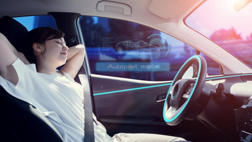 Sleeping woman in autonomous car. self driving vehicle. autopilot. automotive technology. | Shutterstock HD Video #1040691395