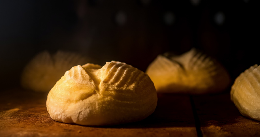 Warm fresh ciabatta in a bakery. Making bread and eco production. Manufacturing process working hard. Bakery shop and selling rooty. Baking Italian bio bread in oven. Time lapse footage of cooking. Royalty-Free Stock Footage #1040714132