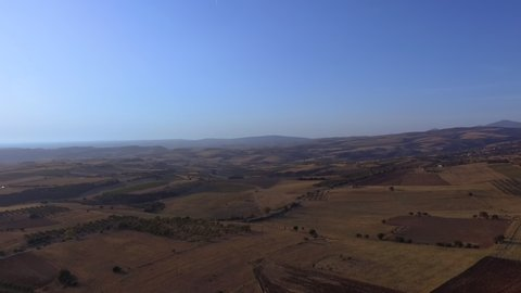 Aerial drone footage of beautiful landscape with fields for planting. Bird view of countryside and nature