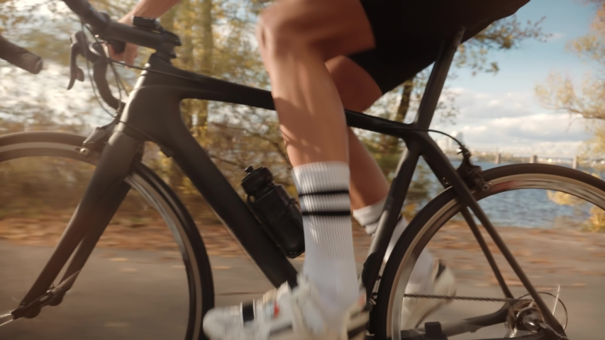 Cyclist Twists Pedals And Riding On Bicycle.Cycling Athlete Cardio Endurance Workout.Gear System And Bike Wheel Rotation.Cyclist Legs Triathlete Pedaling And Exercising Before Triathlon.Sport Concept | Shutterstock HD Video #1040729783