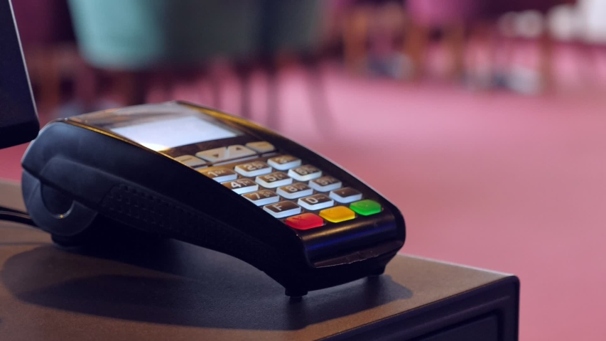 Payment terminal closeup in restaurant, nobody | Shutterstock HD Video #1040732507