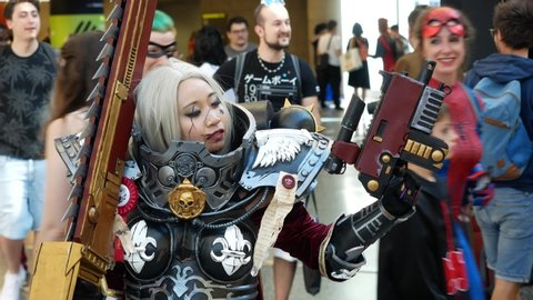 Montreal, Quebec, Canada - 7 July 2019: Comiccon: Cosplayer poses then smiles to camera