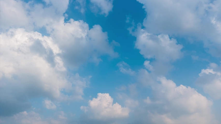 Building motions clouds. Puffy fluffy white clouds sky time lapse. slow moving clouds. B Roll Footage Cloudscape timelapse cloudy. footage timelapse nature 4k. background worship christian concept.