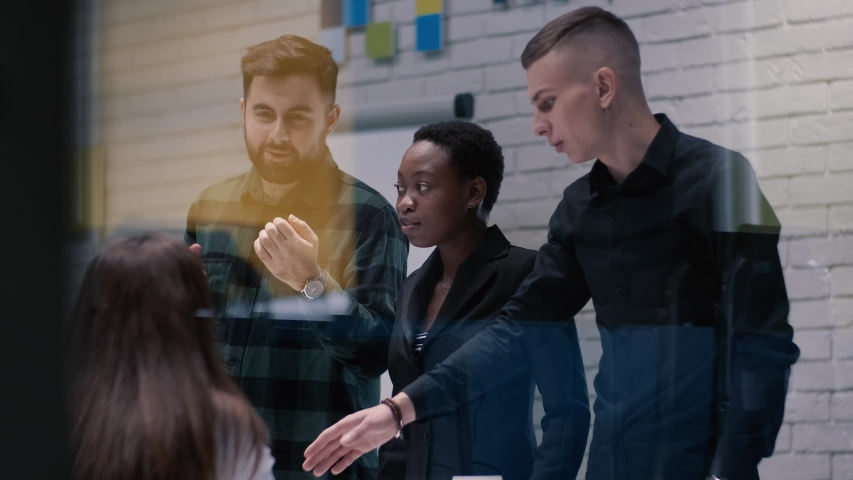 Business colleaguesare planning together and talking lively in the meeting room. Teamwork and brainstorming concept. | Shutterstock HD Video #1040760341