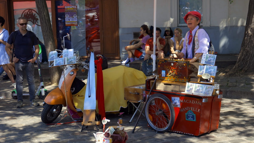 Paris, France - July 2019 : Street singer on the Place du Tertre, famous for its draftsmen and painters in Montmartre in Paris France