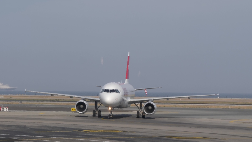 Nice, France - July 5, 2019: 4k Swiss Air aeroplane taxiing on runway at Nice Airport France on the Mediterranean coast, popular travel destination for holiday makers seeking sunshine and summer heat