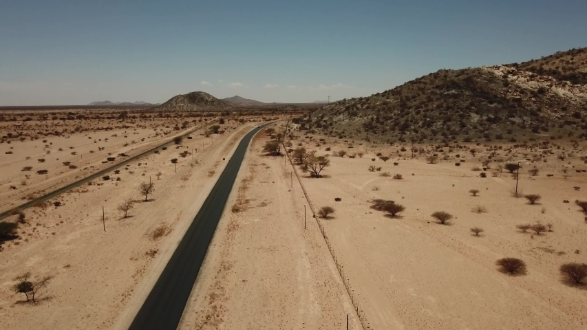 4K aerial drone video of gravel plains and Erongo Mountains near town Usakos, B1 highway to west coast of Namibia and dry waterless hot bushy savanna in Karibib District, central Namibia