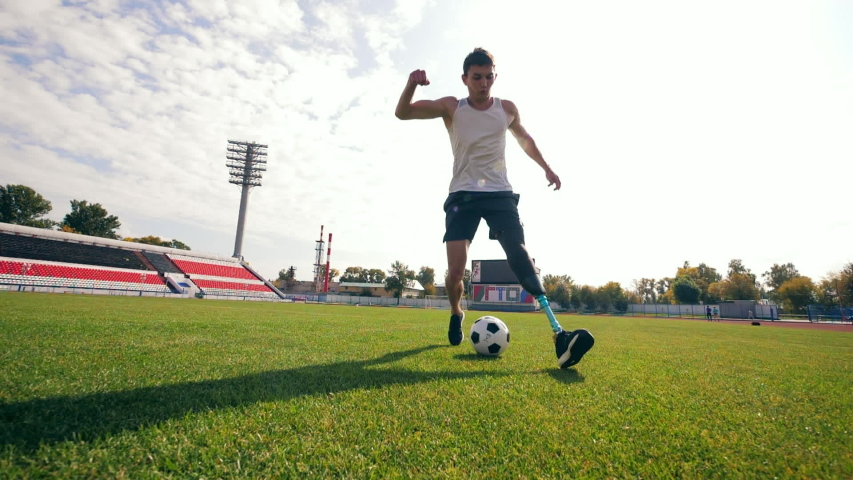 Disabled man with a bionic leg is playing football