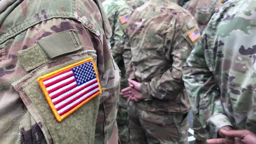 US soldiers. US army. USA patch flag on the US military uniform. Soldiers on the parade ground from the back. Veterans Day. Memorial Day. Royalty-Free Stock Footage #1040827106