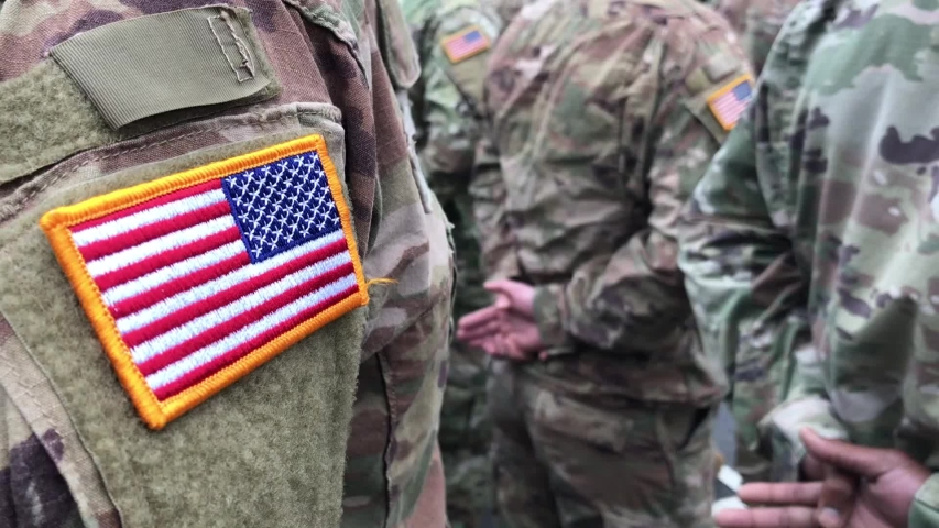 US soldiers. US army. USA patch flag on the US military uniform. Soldiers on the parade ground from the back. Veterans Day. Memorial Day.