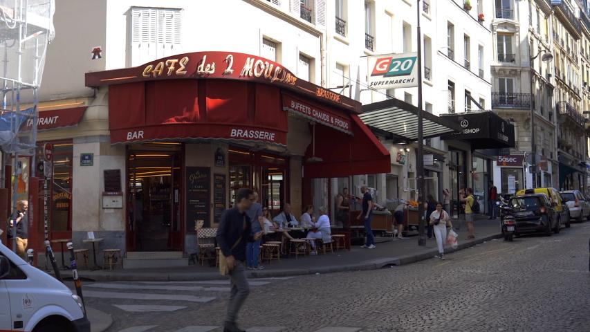 Paris, France - June 2019 : Café des Deux Moulins facade in Pigalle near the Montmartre district in Paris France