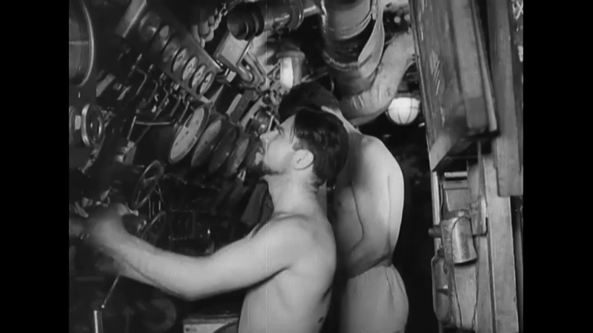 CIRCA 1943 - Italian sailors look through the periscope on their submarine. They crest in time to see an Allied merchant ship sinking.