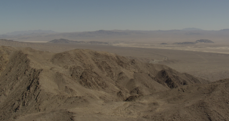 Aerial shot, day, southern california desert mountain range, drone