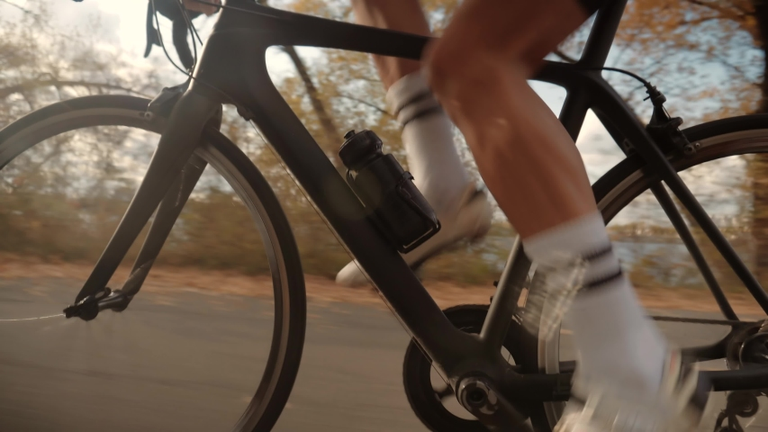 Cyclist Legs Triathlete Pedaling And Exercising Before Triathlon.Cyclist Twists Pedals And Riding On Bicycle.Cycling Athlete Cardio Endurance Workout.Gear System And Bike Wheel Rotation.   Shutterstock HD Video #1040862977