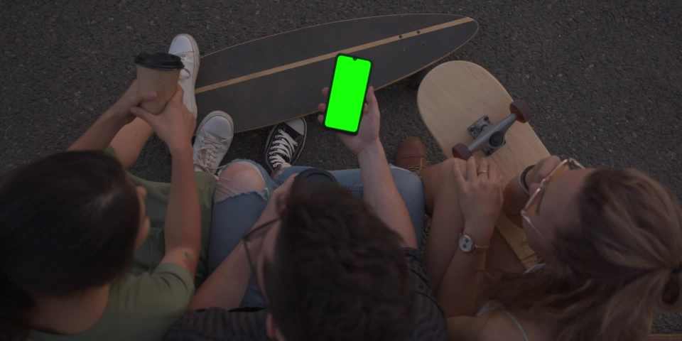 Green screen, CINEMATIC SHOT of friends hipsters millennials multinational girls young women and men sitting outside drinking coffee and chatting, talking. Slow motion | Shutterstock HD Video #1040880983
