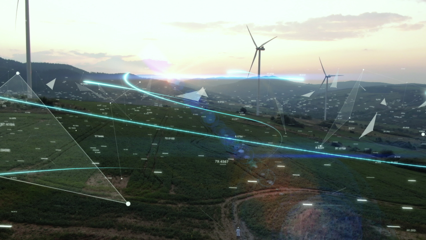 Futuristic Technology Concept. Scientist with Tablet Sending Data to Global Digital Network over Ecology Safe Alternative Energy Source. Visualization Flowing Information. Aerial shot of wind turbines