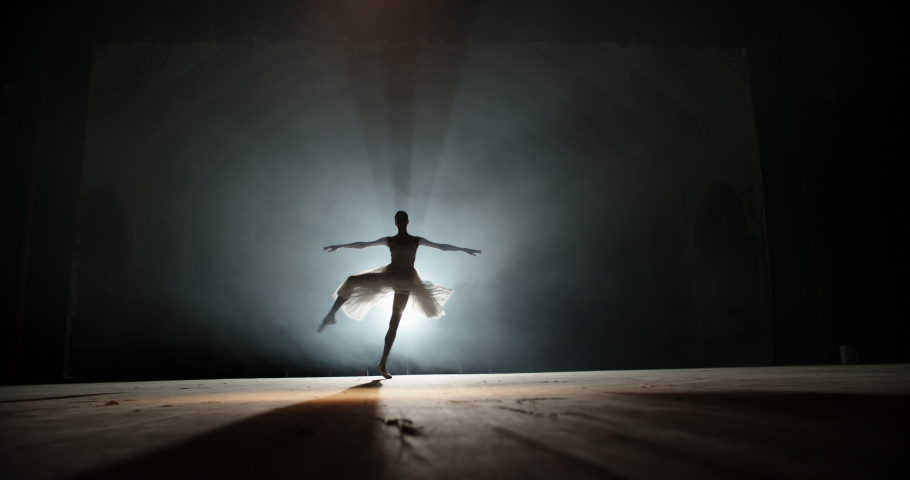 Creative female choreographer setting a ballet performance, dancing and doing various moves on spotted stage - arts concept 4k footage