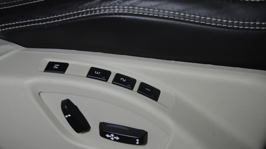 Right hand drive car electrical driver seat adjustment to move forward backward and recline with position  memory button | Shutterstock HD Video #1040891321
