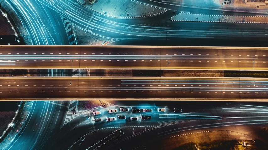 Hyperlapse timelapse of night city traffic on 4-way stop street intersection circle roundabout in bangkok, thailand. 4K UHD horizontal aerial view. #1040898629