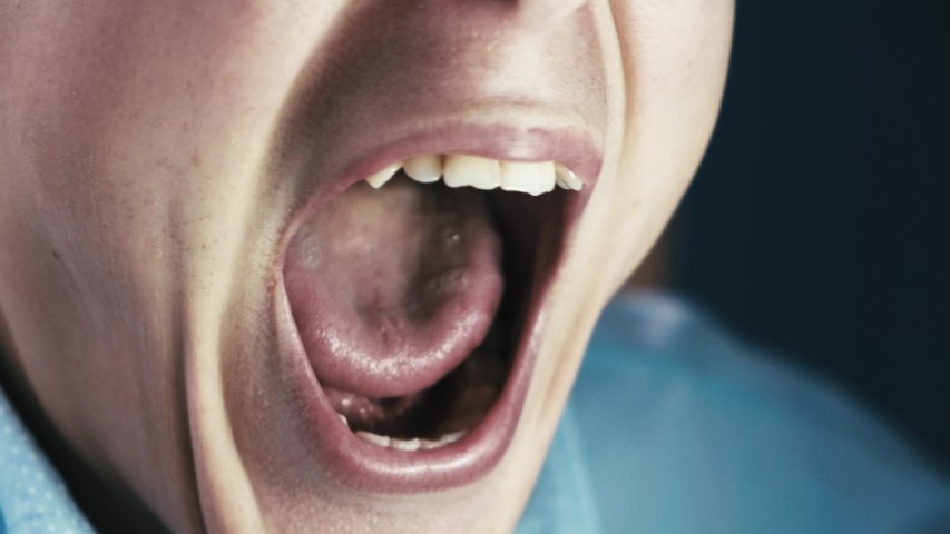 Crazy nervous man screaming with his mouth wide open, close-up | Shutterstock HD Video #1040906828