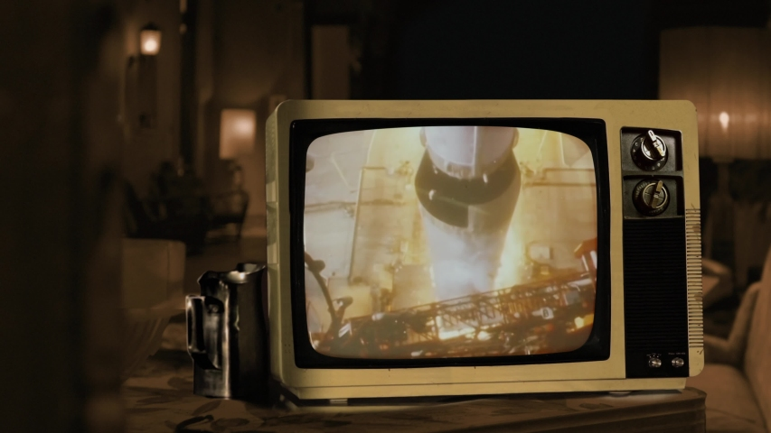 Apollo 11 launches from Kennedy Space Center Cape Canaveral in 1969. Seen on a Retro TV. Sepia Tone. Elements of this video furnished by NASA. 4K Resolution.