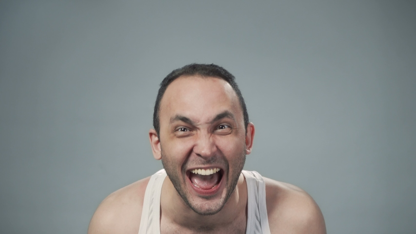 Video of young bristly man with madness laughter | Shutterstock HD Video #1040914082