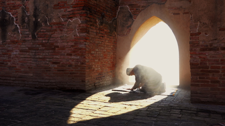 Muslim man praying at an old mosque in Phra Nakhon Si Ayutthaya Province, Thailand, Asian Muslims | Shutterstock HD Video #1040915843