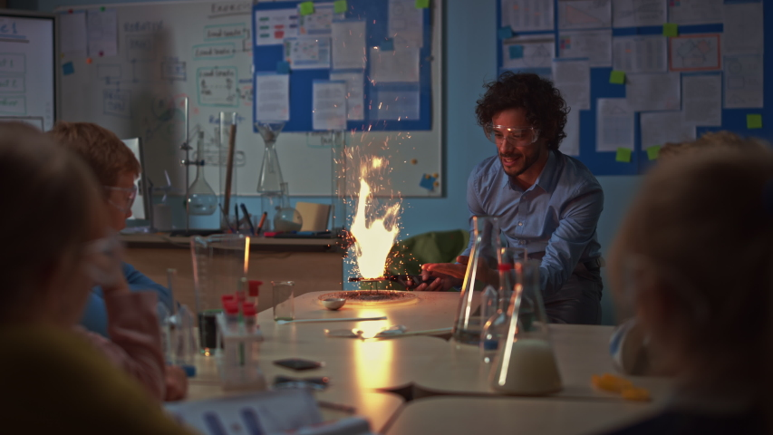 Elementary School Chemistry Classroom: Engrossed Children Watch How Enthusiastic Teacher Shows Science Experiment by Setting Powder on Fire Creating Beautiful Fireworks. Kids Getting Modern Education | Shutterstock HD Video #1040916554