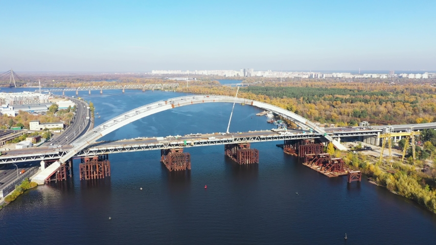 Unfinished Bridge on the River in a big city. Camera Tracking from left to right. | Shutterstock HD Video #1040936813