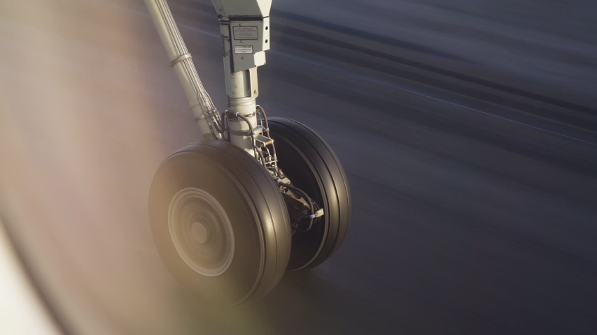 Airplane landing gear takeoff and retraction in Finland passenger window view | Shutterstock HD Video #1040940017