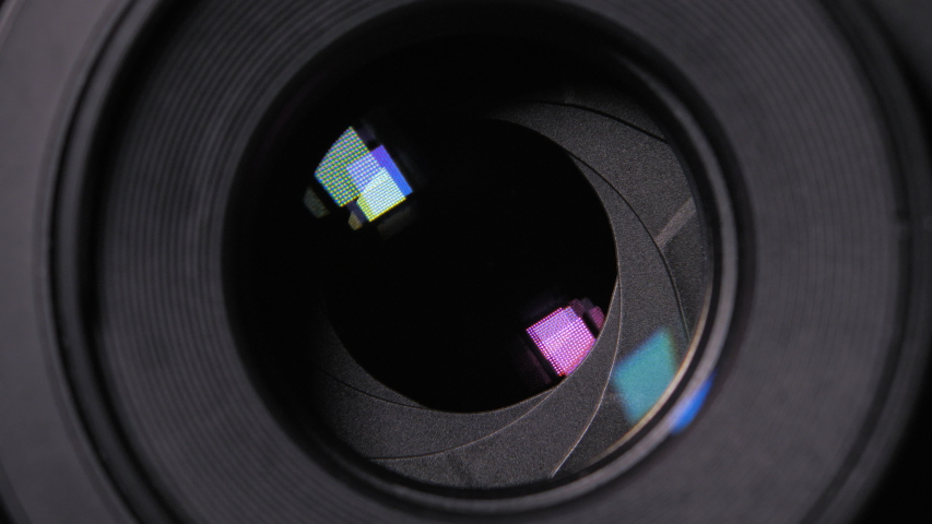 Diaphragm blades of the fixed lens opening and closing aperture f-stop adjustment of a photo camera close-up shot with HUD animation