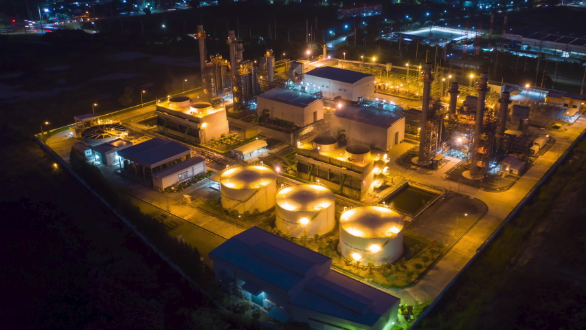 Hyperlapse Timelapse Aerial view drone of oil refinery terminal is industrial facility for storage of oil and petrochemical. oil manufacturing products. power electric plant. footage b roll time lapse
