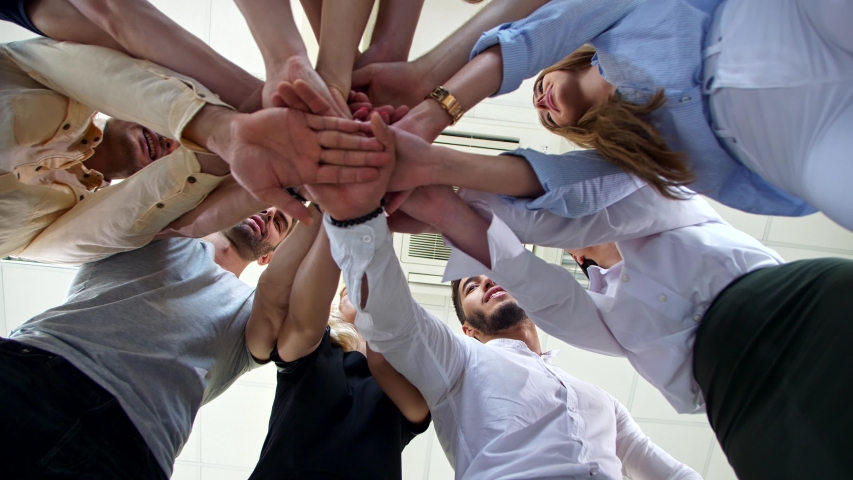 Company of young employees Low Angle View Stacking Hands Together in office Royalty-Free Stock Footage #1040963630