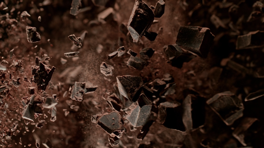 Super Slow Motion Shot of Raw Chocolate Chunks and Cocoa Powder after Being Exploded Towards The Camera at 1000fps. | Shutterstock HD Video #1040974472