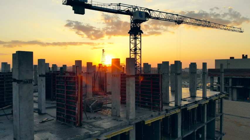 High crane works on building site with a house. Royalty-Free Stock Footage #1040984291