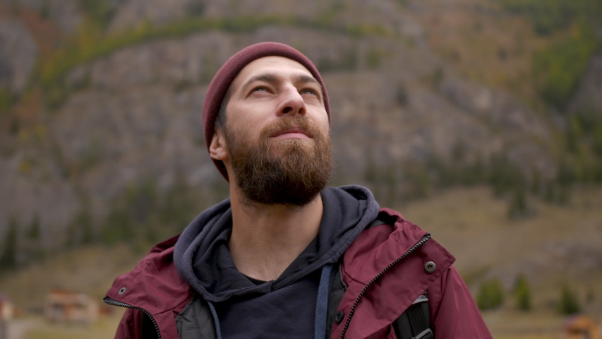 Satisfied Traveler Guy Stands in Picturesque Place of Wildlife and Looks at Autumn Landscape and Beautiful Mountains. Concept People Traveling and Success. Low Angle Shot of 30s Man in Nature Closeup Royalty-Free Stock Footage #1040984531