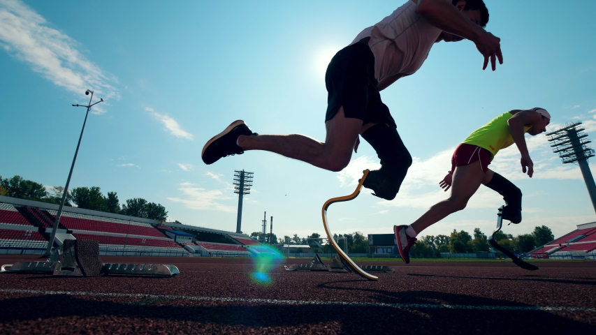 Paralympians with artificial legs are practicing in running