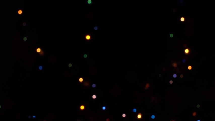 Bokeh lights on black background. defocus. Black alpha green screen animation | Shutterstock HD Video #1040993531
