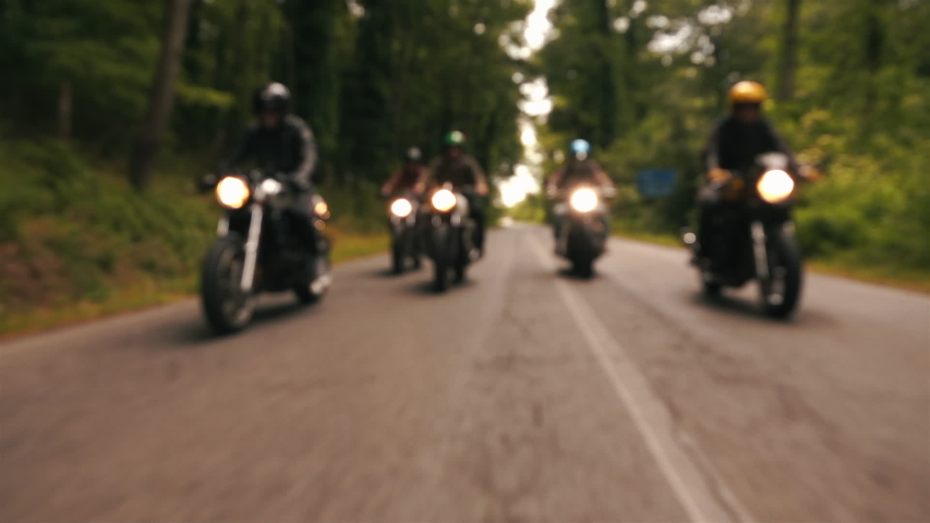 BLURRED SCENE FOR TITLE AND LOGO - group of motorcyclists runs together on old cafe racer. Motor passion.  | Shutterstock HD Video #1040999492