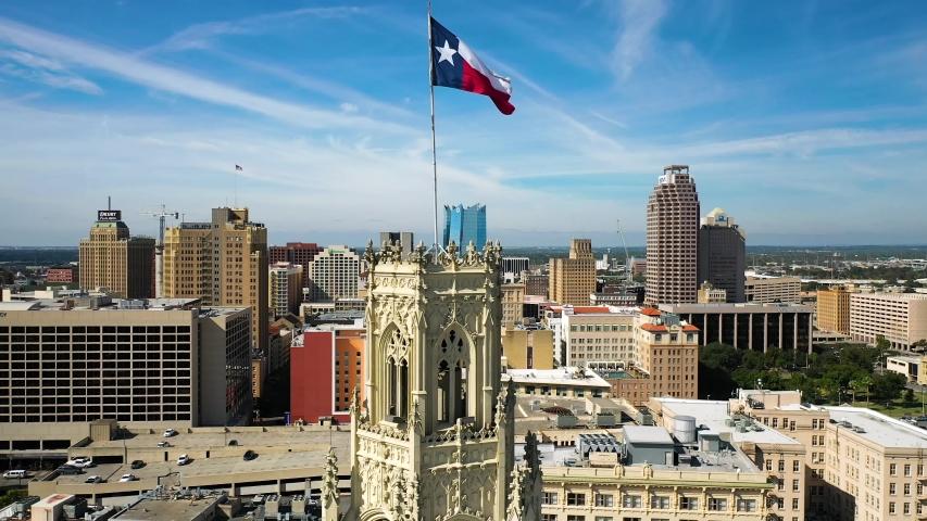 4K Slow Motion Rising Drone San Antonio Tx Skyline Texas State Flag Blue Sky