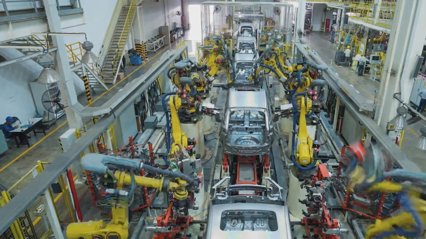 Automotive factory in China. View of the assembly shop, industrial robots collect equipment