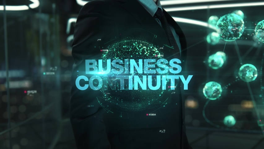 Businessman with Business Continuity hologram concept Royalty-Free Stock Footage #1041034394