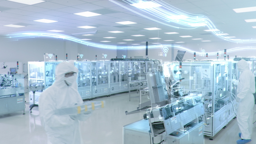 Manufacturing Facility Workers Assembling Products Using Industrial High Precision Machinery. Special Effects Animation: Digitalization of Factory. Industry 4.0 Concept of IOT