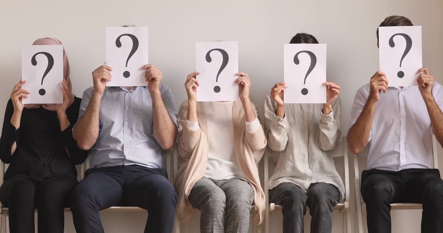 Jobless job seekers human resource sit in queue row sit on chairs hold papers hide face with question marks, unemployed professional business people waiting for employment interview, recruit concept Royalty-Free Stock Footage #1041062033