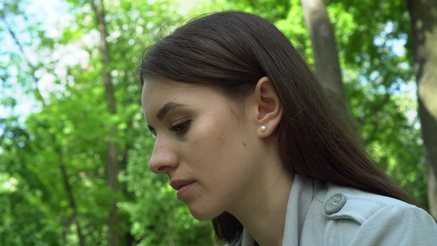 Girl in a park listening to the music | Shutterstock HD Video #1041065708