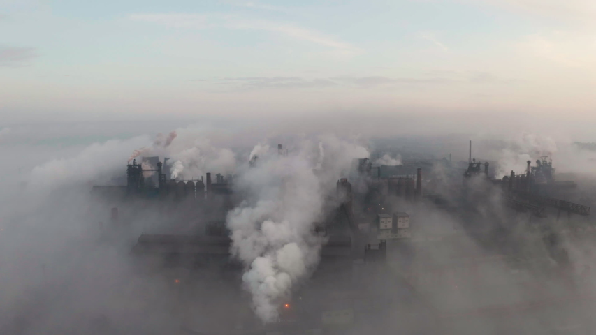 Aerial view. Emission to atmosphere from industrial pipes. Smokestack pipes shooted with drone. Royalty-Free Stock Footage #1041090460